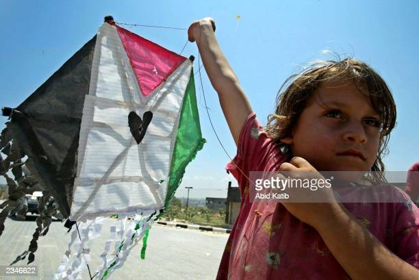 Palestinian child flies a Palestinian flag kite June 3 at Beit Hanoun in northern Gaza Strip US President George W Bush met with Arab leaders today...