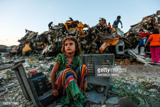 Palestinian child plays in an impoverished area of the Khan Yunis refugee camp southern Gaza Strip on July 29 2018