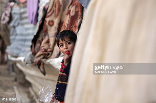 Palestinian child poses for a photo in a povertystricken quarter of Beit Lahia town in the northern Gaza Strip on January 5 2016 AFP PHOTO /MAHMUD...