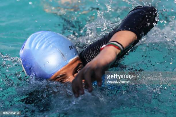 Palestinian child practices during a training session for the dream of competing in The Tokyo 2020 Summer Olympics in Gaza City, Gaza on October 10,...