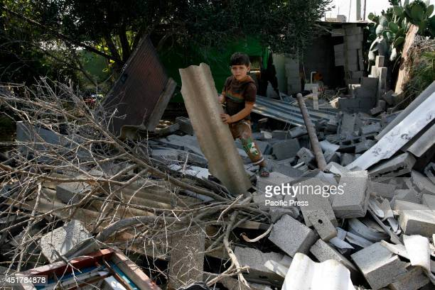Palestinian child stands amidst the rubble of a destroyed building following an Israeli air strike in Rafah. Israeli aircrafts attacked 10 sites used...