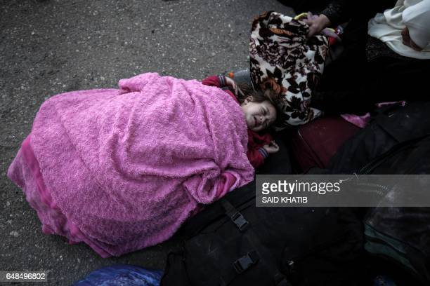 Palestinian child waits for travel permits to cross into Egypt through the Rafah border crossing after it was opened by Egyptian authorities for...