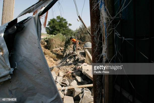 Palestinian child walks amidst the rubble of a destroyed building following an Israeli air strike in Rafah, southern Gaza Strip. Israeli aircrafts...