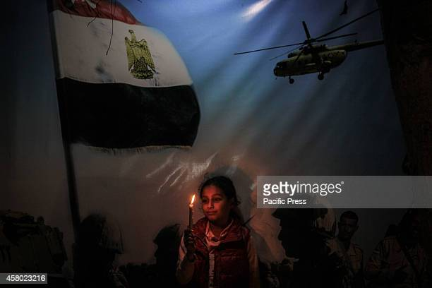 Palestinian children and families lit candles for the souls of the 30 Egyptians soldiers died in a car suicide bomb at the Sinai Peninsula in front...