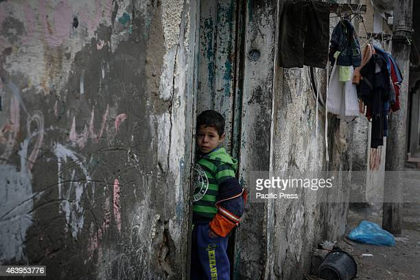 Palestinian children and family in the street during a rainy day in Shati refugee camp during rain storm in Gaza City