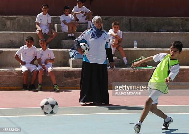 Palestinian children attend a football training session given by Spanish club Real Madrid in the West Bank city of Ramallah on March 23, 2015 as part...
