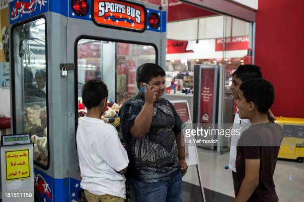 Palestinian children hang out at the Plaza Mall on September 18 2013 in Ramallah West Bank The West Bank is a landlocked territory which has an...