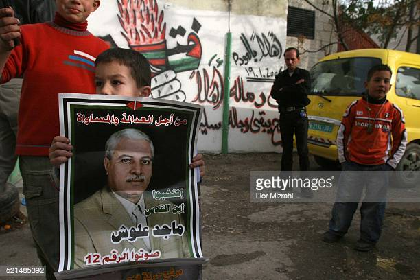 Palestinian children hold an election poster in Abu Dis Sunday January 22 2006. Palestinian Authority Chairman Mahmoud Abbas' Fatah party will only...