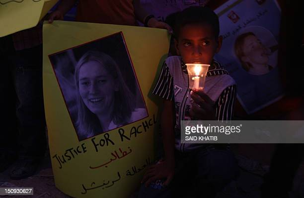 Palestinian children hold candles during a rally at a refugee camp in Rafah in the southern Gaza Strip on August 29 in solidarity with Rachel Corrie...