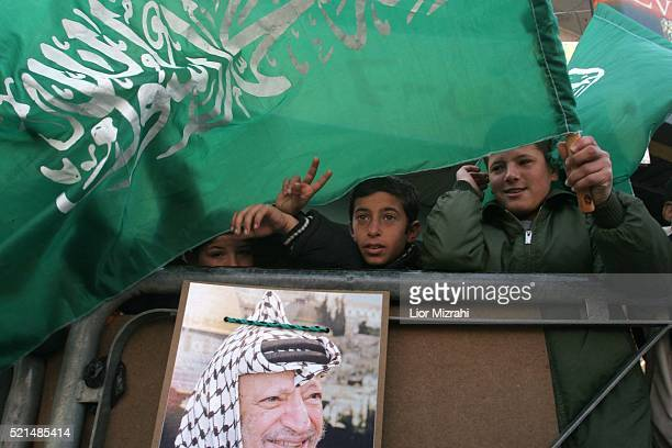 Palestinian children hold Hamas flags in Manara roundabout in the West Bank city of Ramallah Monday, January 23, 2006. The Palestinian legislative...