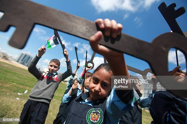Palestinian children hold keys during a rally marking the Nakba or the ''Day of Catastrophe'' in front of the United Nations Development Programme...