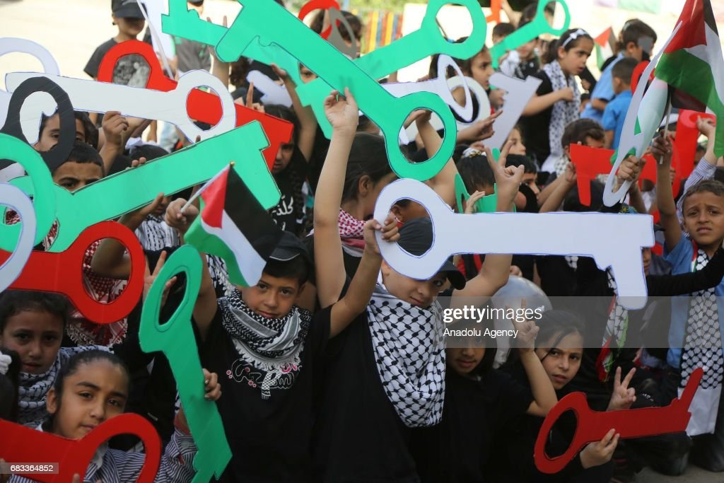 Palestinian children hold model keys symbolizing the houses which Palestinians left as part of the Nakba, during a demonstration marking the 69th anniversary of Nakba, also known as Day of the Catastrophe in 1948, Ramallah, West Bank on May 15, 2017. Palestinians marched from the cemetery of former Palestinian President Yasser Arafat, Arafat Mausoleum to Yasser Arafat Square.