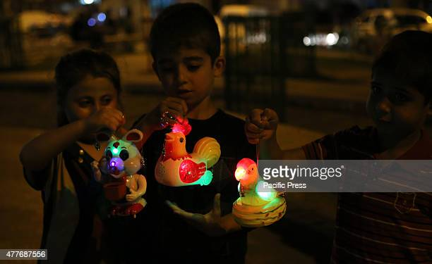 Palestinian children holds traditional lanterns known in Arabic as ''Fanous'' during the advance celebration of the Muslim holy month of Ramadan in...