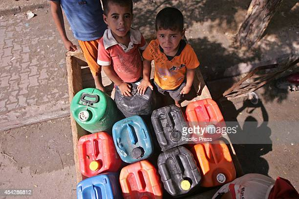 Palestinian children in front of a desalination plant after the war ended officially in Rafah Southern Gaza strip