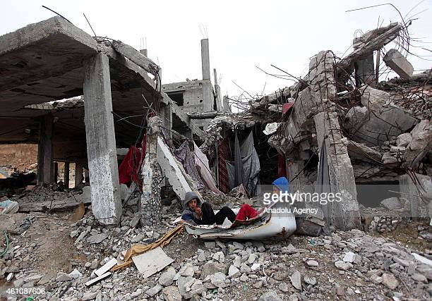 Palestinian children play among the debris of houses destroyed during Israel's latest 50day airstrikes in Shujaiyya neighborhood of Gaza City Gaza on...