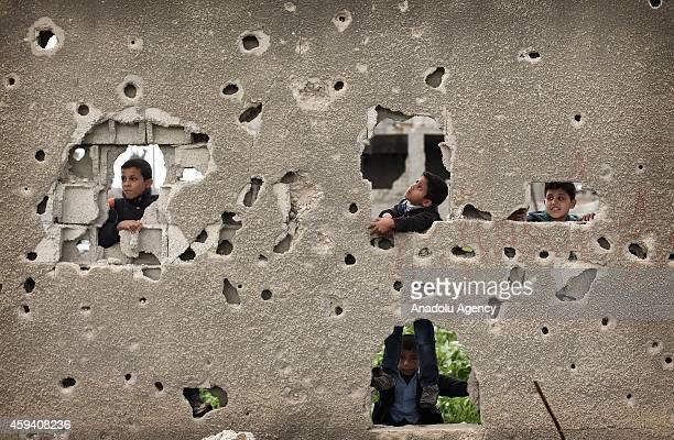 Palestinian children play around a damaged house in Gaza City Gaza on November 22 2014