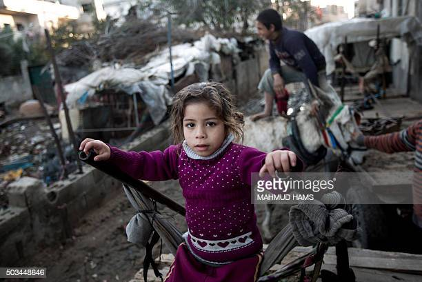 Palestinian children play in a povertystricken quarter of Beit Lahia town in the northern Gaza Strip on January 5 2016 AFP PHOTO /MAHMUD HAMS / AFP /...