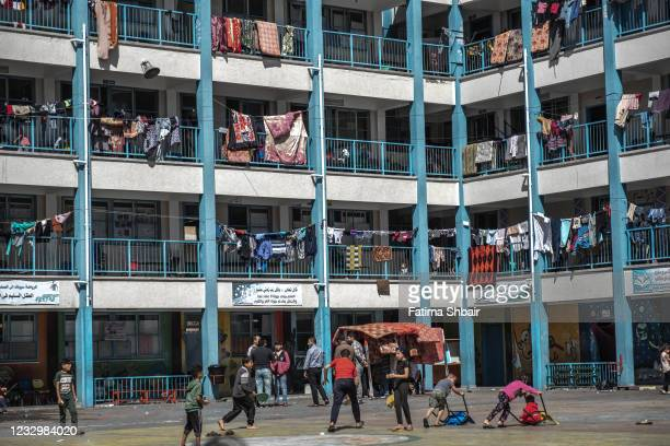 Palestinian children play in a UNRWA school, where some families are now living, following Israeli raids on the northern city of Beit Hanoun in...