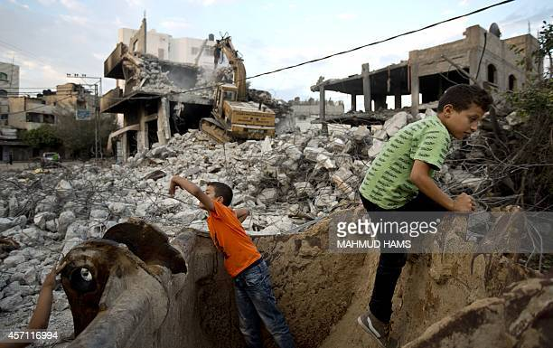 Palestinian children play in the rubble of destroyed homes and buildings from the 50day conflict between Hamas militants and Israel in Shejaiya...