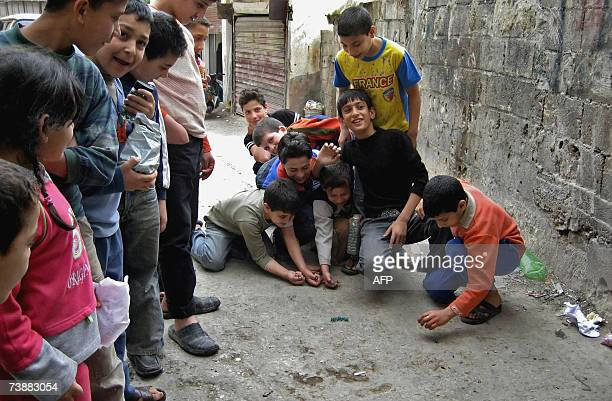 Palestinian children play marbles in an alley of Nahr alBared refugee camp northern Lebanon 05 April 2007 The Palestine Liberation Organisation has...