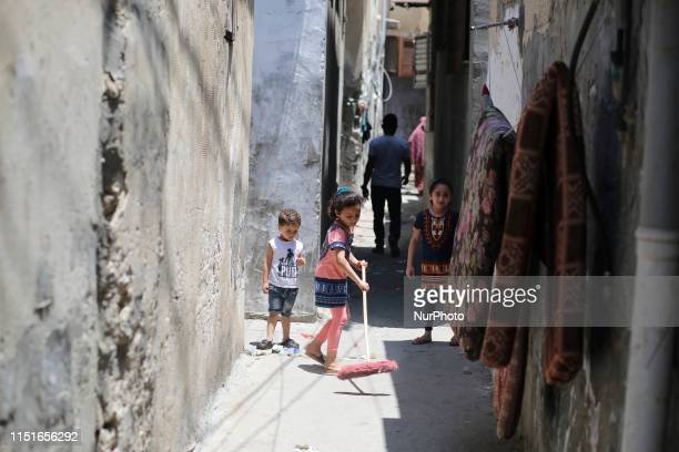 Palestinian children play next to their home in the Gaza Strip's alShati refugee camp on June 23 2019 Israel will attend an upcoming conference on...