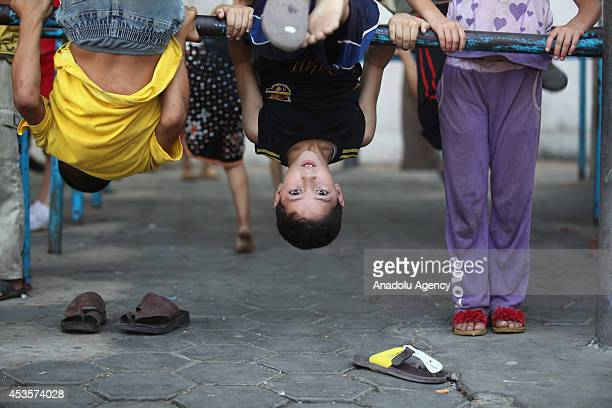 Palestinian children plays during marriage ceremony of Palestinian Omar Abu Nemir taking shelter to UN Relief and Works Agency for Palestine Refugees...