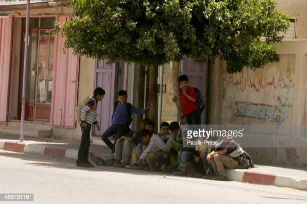 "Palestinian children sit on the edge of the pavement in a street in Rafah in the southern Gaza Strip. Nakba, or ""catastrophe"", marks Israel's..."