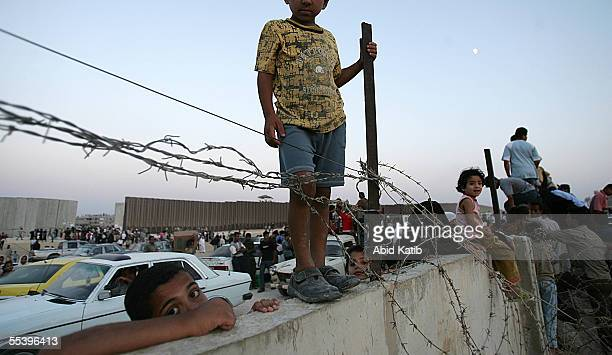 Palestinian children stand on the wall while others cross the now EgyptianPalestinian controlled border September 13 2005 in Rafah Gaza Thousands of...