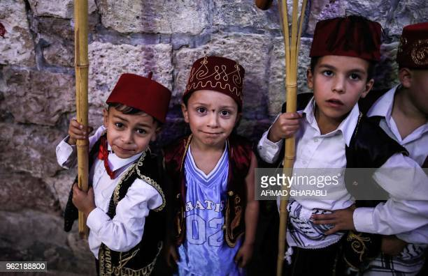 TOPSHOT Palestinian children take part in a celebration in Jerusalem's Old City to celebrate breaking the fast on the eighth day of the Islamic holy...