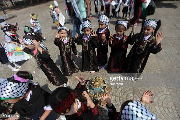 Palestinian children take part in a protest against an Israeli police raid on Jerusalem's al-Aqsa mosque, in Gaza city on 1st October 2015
