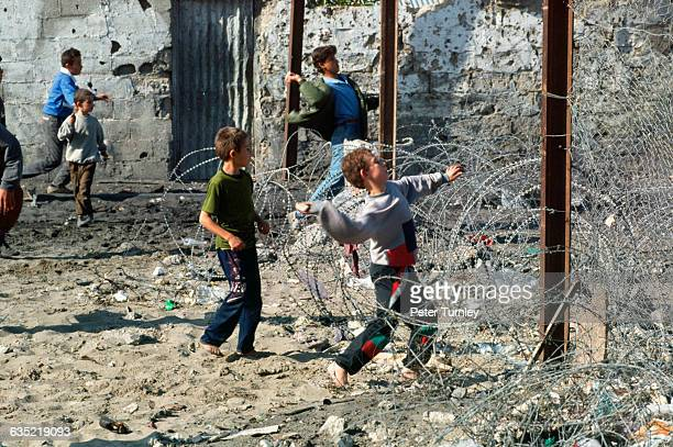 Palestinian children throw rocks at an Israeli army base