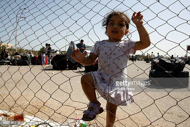 Palestinian children wait to cross into Egypt at the Rafah border crossing between Egypt and the southern Gaza Strip. After the Egyptian President...