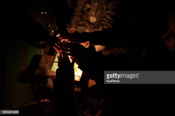 Palestinian children warm their hands on candles during a vigil against the ongoing blockade and constant power cuts in Gaza City on November 12 2013...