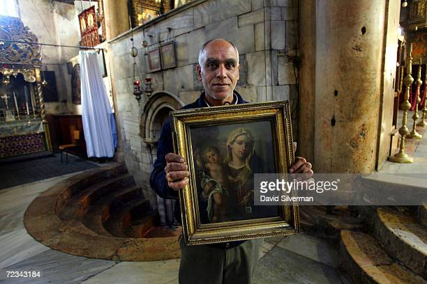 Palestinian Christian carries an icon of the Madonna and Child to be cleaned in the Church of the Nativity the traditional site of Jesus birth on...