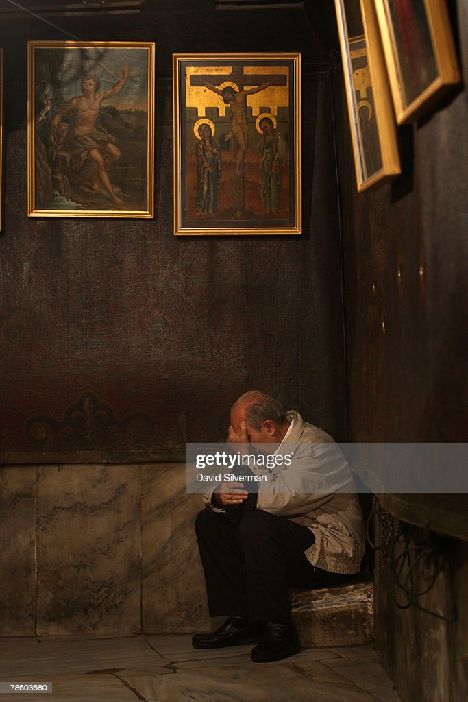 A Palestinian Christian prays in silence in a corner of the Grotto of the Church of the Nativity, the traditional birthplace of Jesus, on December 21, 2007 in Bethlehem in the West Bank. The biblical town is celebrating both Christmas and the Muslim Eid al-Adha over the next few days.
