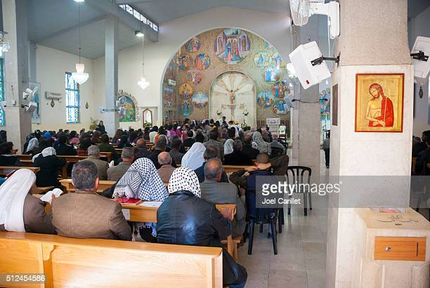 Palestinian Christians at mass in West Bank town of Zababdeh