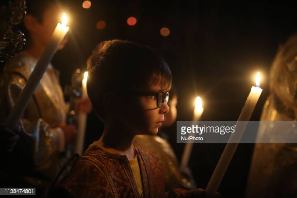 Palestinian Christians religious take part in Palm Sunday celebrations at a Greek Orthodox church during Easter celebrations in Gaza City Sunday 21...