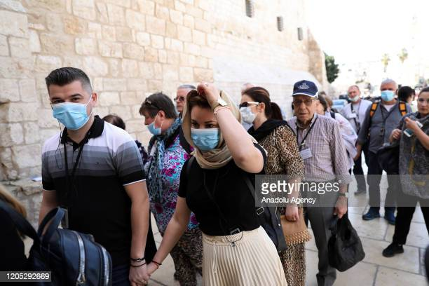 Palestinian citizens wear masks to protect themselves from coronavirus at public places in Bethlehem West Bank on March 05 2020 The Palestinian...