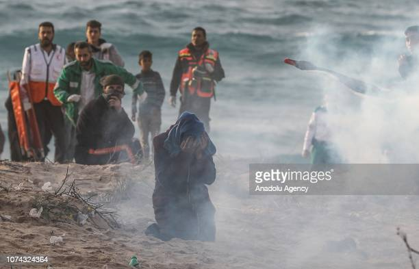 Palestinian closes her face after Israeli forces intervene protesters with gas bombs during the maritime protest against Israels ongoing blockade of...