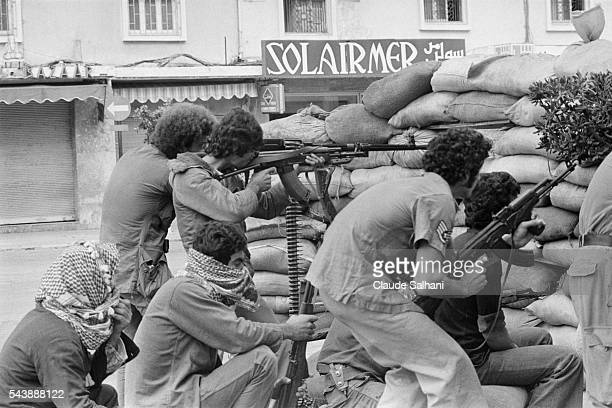 Palestinian combatants maintain their positions in Beirut as they await the results of political negotiations between parties.