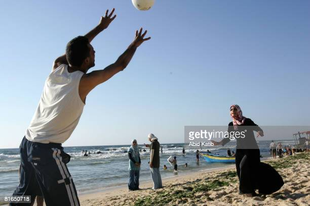 Palestinian couple plays hanball on the beach June 20 2008 in Rafah southern Gaza Strip Today is the second day of a truce between Palestinian...