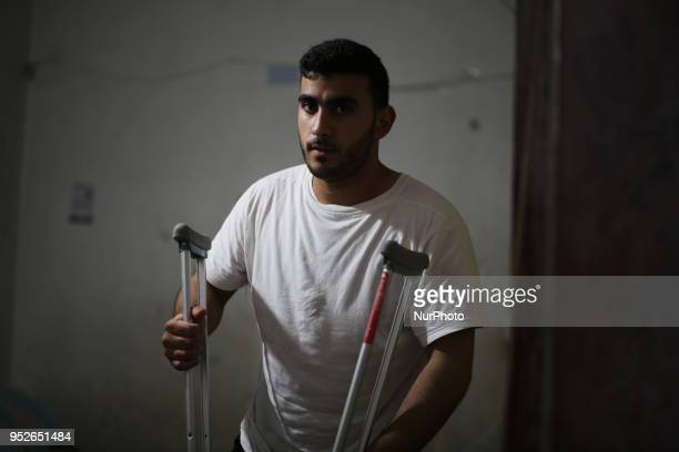 Palestinian cyclist Alaa AlDaly who lost his leg by a bullet fired by Israeli troops during clashes along the borders between Israel and Gaza rests...