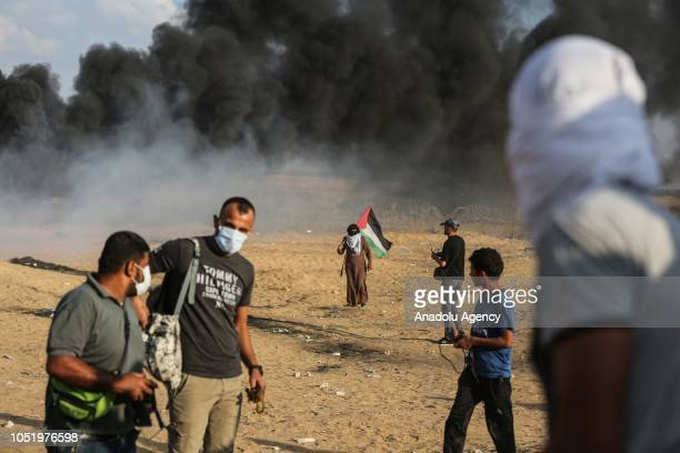 Palestinian demonstrator carries a Palestinian flag during the Great March of Return demonstration near IsraelGaza border in Khan Yunis Gaza on...