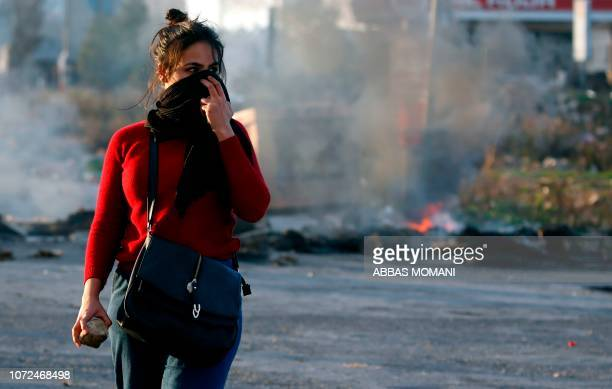 Palestinian demonstrator covers her face during clashes with Israeli troops in Ramallah near the Jewish settlement of Beit El in the occupied West...