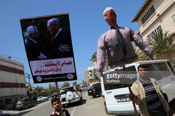 A Palestinian demonstrator holds an effigy depicting Palestinian President Mahmoud Abbas that will be burnt during an anti Abbas protest organized by...
