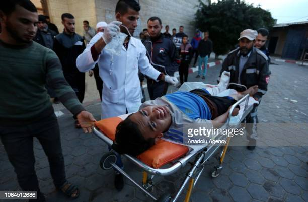 Palestinian demonstrator is being carried with a stretcher by health crews to alaqsa hospital after Israeli forces' intervention during the 'Great...