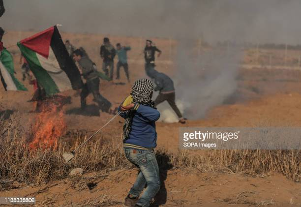 Palestinian demonstrator seen using a slingshot to throw stones during the protest Palestinians clash with the Israeli forces during a protest...