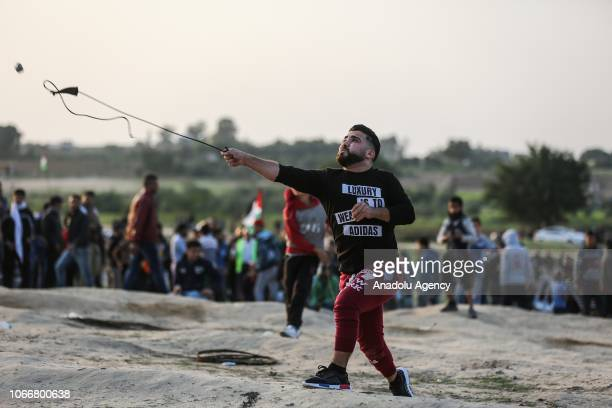 Palestinian demonstrator throws stone in response to Israeli intervention during a Great March of Return demonstration near Al Bureij Refugee Camp on...