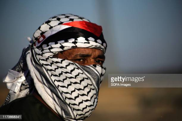Palestinian demonstrator wearing a Palestinian keffiyeh during an antiIsrael demonstration calling for an end to the years of siege on Gaza on the...