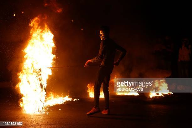 Palestinian demonstrator wears a Guy Fawkes mask during an anti-Israel demonstration over tensions in Jerusalem near the Jewish settlement of Beit El...
